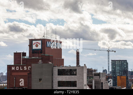 MONTREAL, CANADA - NOVEMBER 8, 2018: Molson Coors logo on Molson Brewery brick tower in downtown Montreal, Quebec. It is one of the biggest beer produ - Stock Image