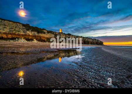 Hunstanton cliffs at twilight with moon. - Stock Image