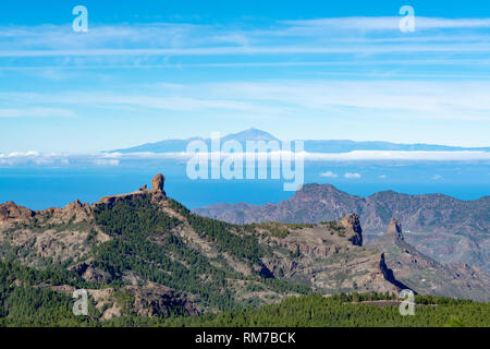 Gran Canaria island mountains and valleys landscape, view from highest peak Pico de las Nieves to Roque Nublo and Mount Teide on Tenerife - Stock Image