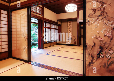 Kanazawa, Japan - November 15, 2018: Tea room with painted screen doors in Nomura Samurai House in Kanazawa. This house is the only samurai house open - Stock Image