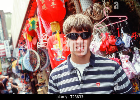 Teenage Boy Touring Chinatown, NYC, USA , 2002 - Stock Image