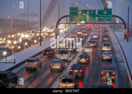 Rush hour traffic in a snow storm over the Zakim Bridge, I-93, Boston Massachusetts USA - Stock Image