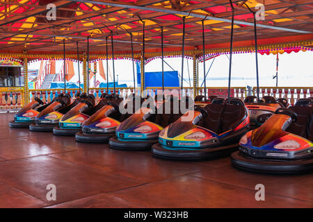 Dodgems or bumper cars lined up at the fairground - Stock Image