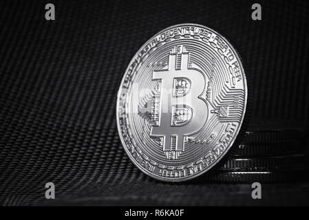Bitcoin cryptocurrency. Heap of bitcoins. Textured background with copyspace - Stock Image