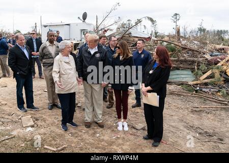 U.S First Lady Melania Trump and President Donald Trump walk with Gov. Kay Ivey, left, as they view damage from a massive tornado March 8, 2019 in Lee County, Alabama. The region was hit by a tornado on March 3rd killing 23 people. - Stock Image
