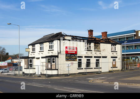 AJ's Cafe, formerly Busters and before that the White Hart pub on Albert Road, Farnworth, as a burnt out shell - Stock Image