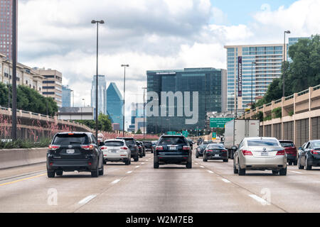 Dallas, USA - June 7, 2019: Downtown highway 75 in city with cars in traffic signs for exits - Stock Image