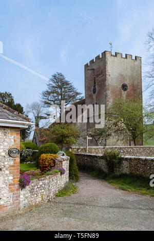 Path to St Mary's country parish church with clock tower in village of Singleton, Chichester, West Sussex, England, UK, Britain - Stock Image