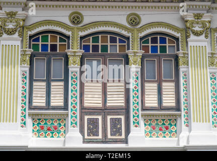 Louvre windows on Colourful Peranakan terraced houses popular with instagrammers on Koon Seng Road, Joo Chiat,  Geylang, Singapore. - Stock Image