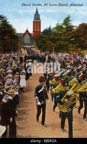Church Parade, Royal Garrison Church of All Saints, Aldershot, Hampshire, with a military band marching and playing. - Stock Image