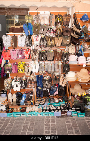Flip flops sandals shoes and hats outside tourist shop Rethymno Crete Greece - Stock Image