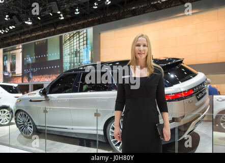 Manhattan, New York, USA. April 12, 2017. Female rep stands in front of Land Rover 2018 Range Rover VELAR, medium - Stock Image