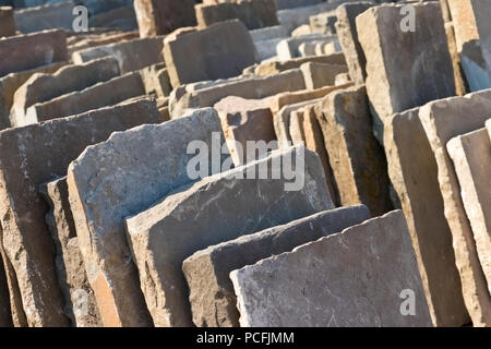 Aged, reclaimed stone tiles. - Stock Image