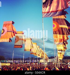 Crowd flags and atmosphere, golden hour, the other stage glastonbury festival 2014 - Stock Image