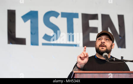 4-21-2018, SPRINT Pavilion, Charlottesville, VA, USA.  Former white supremacist and author Christian Picciolini speaking during Listen First in Charlottesville.  Listen First was part of the first National Week of Conversation (April 20-28, 2018).   Listen First's weekend events in Charlottesville were created to support healing and reconciliation after 2017 white supremacist and pro-confederacy protests left one woman dead and a community divided.  A small number of seats of the 3,500 seat amphitheater were occupied on Saturday as speakers and panel discussions  were presented. - Stock Image