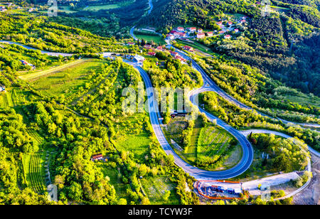 Aerial view of a winding road in Slovenia - Stock Image