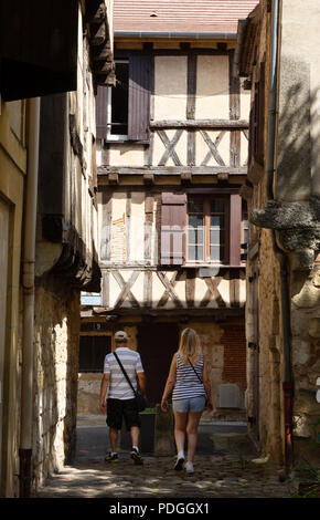 Tourist couple exploring the narrow streets of medieval Bergerac old town, Bergerac, Dordogne, France Europe - Stock Image