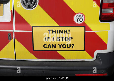 Road safety sign on rear of van, Think if I stop can you ? - Stock Image