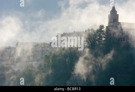 Atmospheric Clouds envelope the historic hilltown of Amandola in the Marche,Marches,in Italy - Stock Image