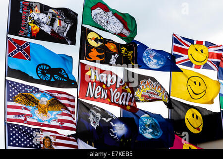 Close up of brightly coloured festival flags flying in the wind. - Stock Image