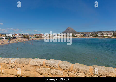 Xabia Spain Playa del Arenal bay in summer with blue sky and people, also known as Javea - Stock Image