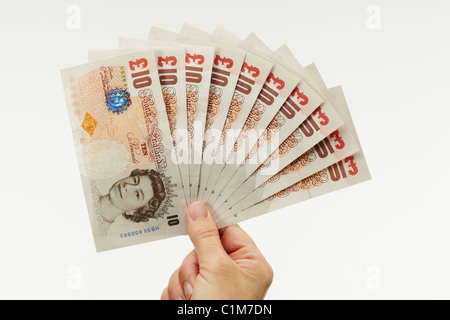 Fan of Ten Pound Notes with Hand - Stock Image