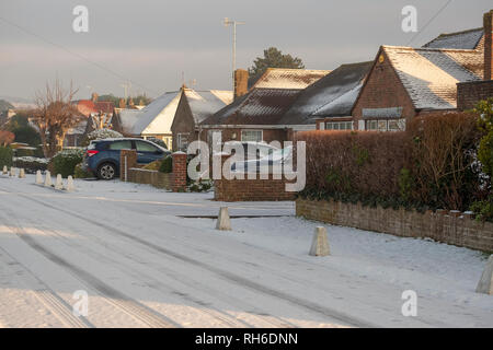 Ferring west Sussex, UK. Friday 1 st Febuary. UK weather. After moderate snowfall last night Ferring wakes to snow covered roads making driving treacherous on untreated roads. Â Credit: Photovision Images News/Alamy Live News - Stock Image
