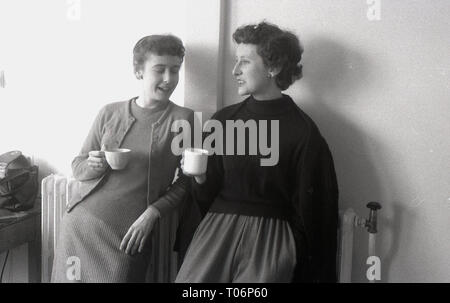 1950s, two female teachers having a chat and a cup of tea, England, UK. - Stock Image