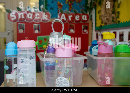 Plastic water bottles at a school that children bring in as a measure to curb use of disposable plastics. The school is in Harlesden, London. - Stock Image