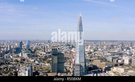London, UK - October 2018: Aerial cinematic shot of the central London skyline featuring The Shard glass tower with a view of St. Paul's Cathedral and - Stock Image