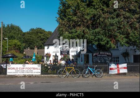 People enjoying warm day at Jolly Brewers pub Milton Cambridge - Stock Image