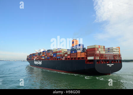 The Hamburg Express, container ship built in 2012 sailing up Southampton Water to the the port of Southampton. - Stock Image