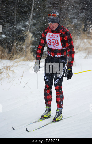 A man skis in the Mora Vasaloppet during a snowstorm on February 10, 2013 in Mora, Minnesota. - Stock Image