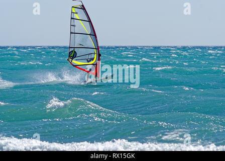 Windsurfer during a mistral windy day in mediterranean sea (St Laurent du Var , France) - Stock Image