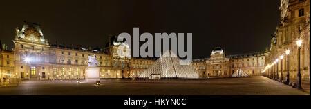 PARIS-APRIL 4: Panoramic view of Louvre Art Museum at night. The Louvre is the biggest Museum in Paris displayed - Stock Image