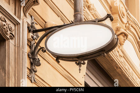 Blank old style store sign with copy space for mockup hanging on a renaissance building - Stock Image