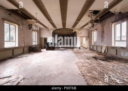 Interior view of an abandoned ballroom that was part of a cafe with a piano,  in Germany. - Stock Image