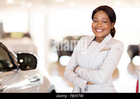 attractive young African vehicle saleswoman - Stock Image