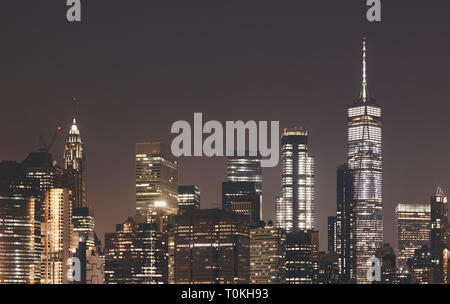 New York City skyline at night, color toning applied, USA. - Stock Image