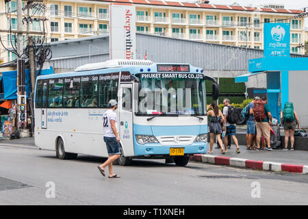 Phuket, Thailand 17th January 2019: Tourists boarding the Phuket Smart Bus. The regular service from the airport to Rawai was introduced in 2018. - Stock Image