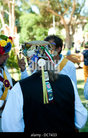 Male Morris Dancer, view from behind, wearing hat with ribbons - Stock Image