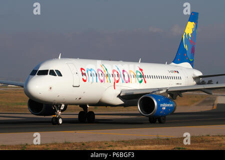 Small Planet Airlines Airbus A320 commercial jet plane taxiing for departure. Front view closeup. - Stock Image