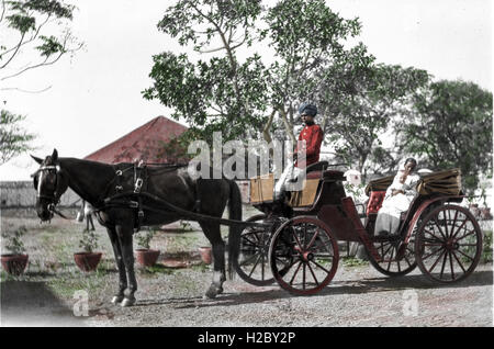 Horse and carriage outside Lt.Col Austin Frost's home in Poona. The baby (Tom Frost) is being held by his Ayah - Stock Image