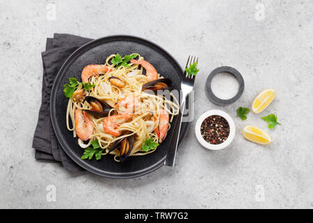 Spaghetti seafood pasta with clams and prawns. Top view with copy space. Flat lay - Stock Image