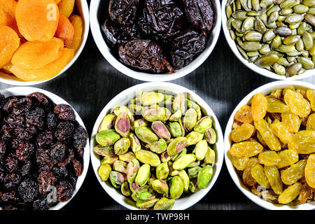 Pistachio Nuts, Pumpkin Seeds, Raisins, Sultanas Prunes and Dried Apricots Fruit and Nut Healthy Selection of Good Eating - Stock Image
