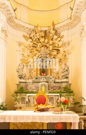 Italy Sicily ancient Netum Noto Antica Mount Alveria rebuilt after 1693 earthquake Chiesa Church di San Carlo altar crucifix statues marble flowers - Stock Image