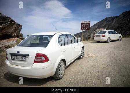 Two hire cars, Ford Ikons, near the top of the Swartberg Pass, heading north on the R328 road in the Western Cape, - Stock Image