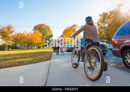Merrick, New York, USA. Nov. 08, 2016. On Election Day, a family, a mother, father, and two young daughters, rode - Stock Image