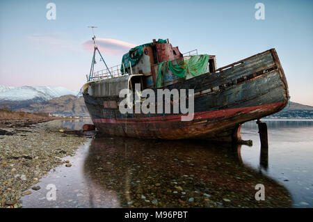 An abandoned fishing boat on a beach of Loch Linnhe,corpach Scotland. - Stock Image