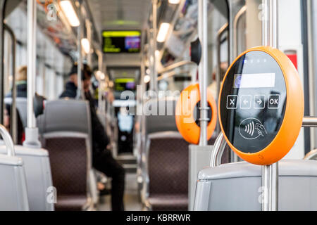 Orange modern magnetic ticket validator - Stock Image